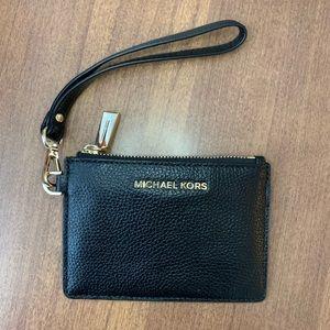Michael kors coin purse wristlet in black.